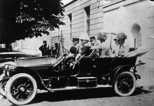 The royal motorcade's first stop was to inspect Austrian troops at the Filipoviceva Kasarna, Sarajevo's modern military barracks built by the Habsburgs in the 1890s just down the road from the station. The Archduke's Gräf & Stift open tourer was pictured as it left the barracks shortly thereafter. Franz Ferdinand and Sophie are in the back seats, with Governor Potiorek and Oberstleutnant Franz Count von Harrach, the owner of the car, in front of them. At the wheel is chauffeur Leopold Lojka, and sitting beside him is Gustav Schneiberg, the Hofkammerbüchsenspanner (Court Armourer), a member of the Archduke's hunting staff. Note the Archduke's pennant flying from the car.
