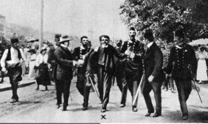 Immediately after throwing his bomb, Cabrinovic tried to commit suicide by swallowing cyanide and jumping into the river. However, his attempt failed and he was dragged out of the water and arrested. Here he is being escorted to the police station by gendarmes, who had trouble defending him from assaults by the angry crowds.