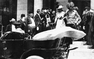 The reception in the Town Hall over, and with Franz Ferdinand having decided that he wants to visit his wounded adjutant in the hospital, the royal couple emerges from the building.